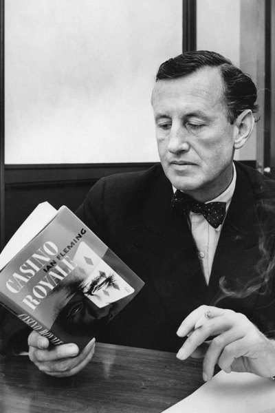 Fleming reading a copy of Casino Royale